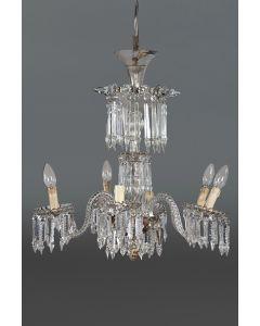 2011-Lámpara de techo de seis brazos en cristal siguiendo modelos de La Granja con prismas facetados. puntas y cuentas de cristal. C. 1900. Algún desperect