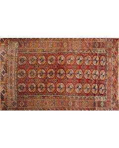 360-Alfombra persa en lana con decoración geométrica sobre campo granate y cenefa en marrón. Desgastes.